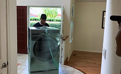 man wrapping a laundry machine