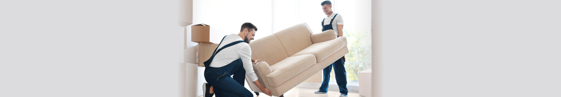 two man moving out the sofa